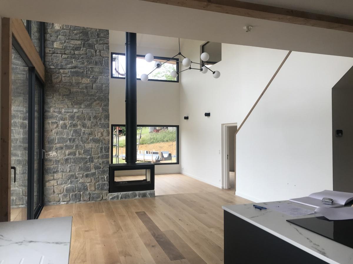 Construction d'une maison individuelle ossature bois BBC : Rdc salon ouvert