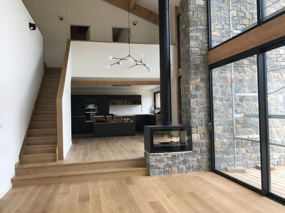 Construction d'une maison individuelle ossature bois BBC : Rdc vue salon/cuisine
