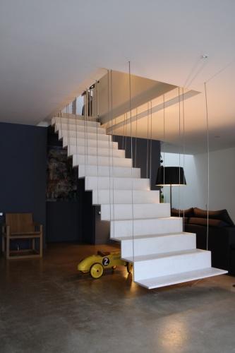 Transformation d'un atelier en loft à Toulouse : loft snaky escalier en beton ductal 1